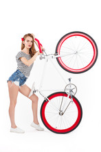 Woman Holding Bicycle Up