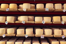 Rows Of Aging Cheese In Production