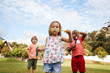 Children At Montessori School Playing With Bubbles During Break