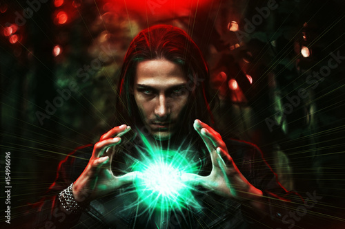 man with a mysterious glowing orb. Fototapeta