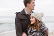 Man and woman are walking on the sea in the spring romance is cold love