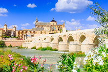 Cordoba, Spain. The Roman Bridge And Mosque (Cathedral) On The Guadalquivir River.