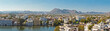Beautiful panoramic view of Udaipur city in Rajastan, India. Famous Pichola Lake, historical buildings with mountains on background