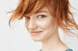 canvas print picture Close up portrait of funny redhead girl smiling looking at camera.