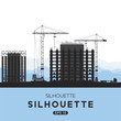 Silhouettes of building houses. Tower crane and houses of monolith. Flat vector illustration EPS10.
