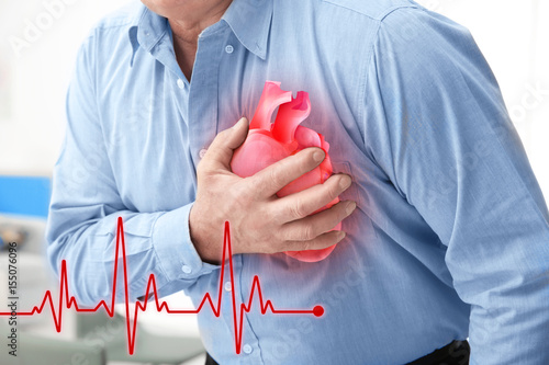 Fotografía  Man with chest pain suffering from heart attack in office