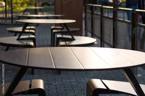 Vászonkép  Empty tables of a street cafe at sunset on a summer evening