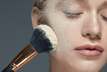 Beauty Makeup. Beautiful Female With Powder On Face And Brush