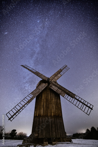 A windmill at the Milky-way Galaxy in the sky in Olsztynek, Poland Poster