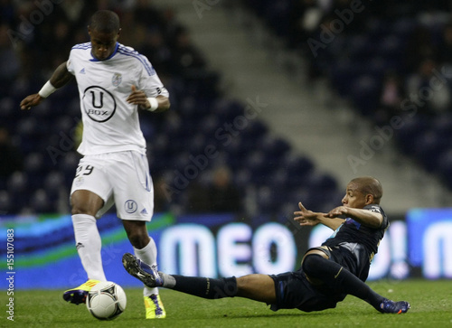 By Miguel Vidal   REUTERS. Porto s Fernando battles for the ball with CD  Feirense s Bedi during their Portuguese Premier League soccer 105af20637c57