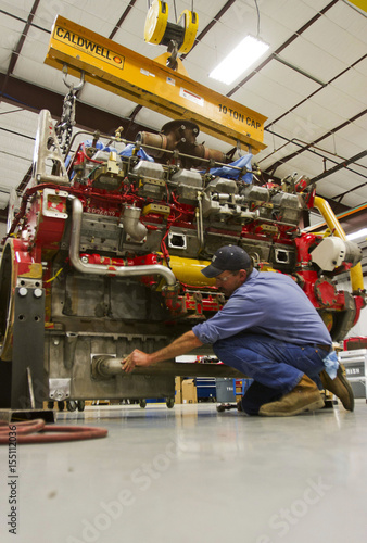 Mechanic Mike Huser works on a CAT 3512 engine used to power
