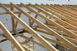 The wooden structure of the building. Wooden frame building. Wooden roof construction. photo for home. house building. Installation of wooden beams at construction the roof truss system of the house.