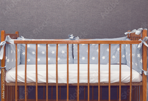 Vintage decorated baby cot Wallpaper Mural