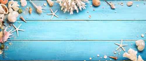 Fotografie, Obraz Seashells On Blue Wooden Background - Beach Concept