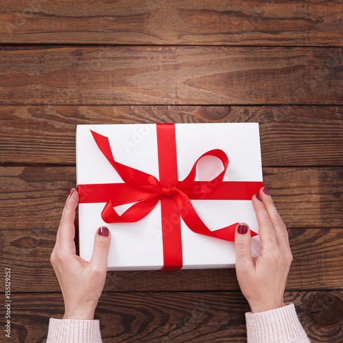 Woman S Hands Wrapping Christmas Holiday Handmade Present In Paper