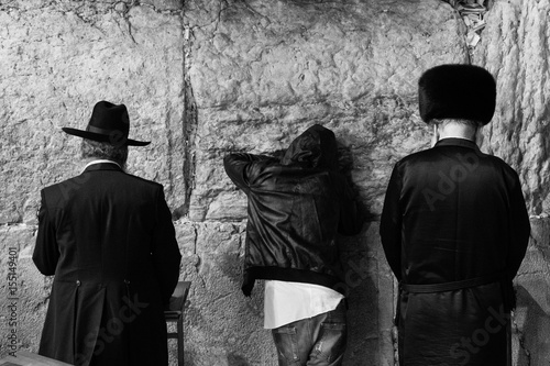 Photo Three different selichot prayers at the wailing wall, the Kotel, at Jerusalem -