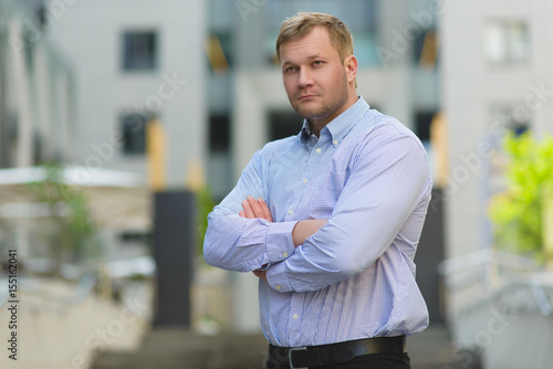 Fototapety, obrazy: Portrait of serious Handsome businessman in blue shirt outdoor