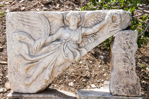 Fotografija  Carving of the Goddess Nike at UNESCO World Heritage Archaeological Site, Ephesu