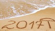 2017 in the form of an inscription on sand, the beach.