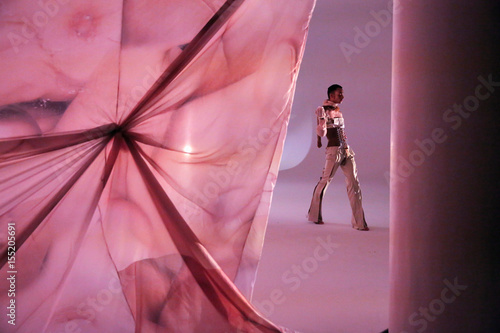 A model presents a creation during the MAISON the FAUX presentation ...