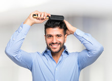 Man Taking Care Of His Hair