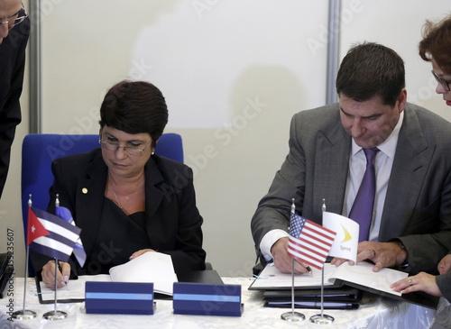 Hilda Arias Perez Central Director Of Mobile Services Etecsa Signs