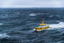 Coast Guard Boat Patrol Riding On Rough Sea Waves In Alaska.