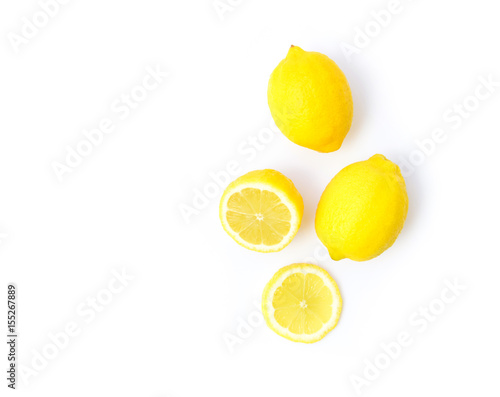 Fotografía  Closeup top view fresh lemon fruit and slice on white background