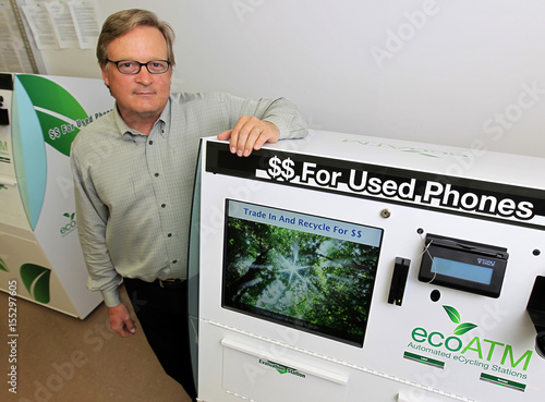 ECO ATM founder Bowles poses for pictures with his company's phone