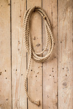 Brown String Hanging On Wooden Wall