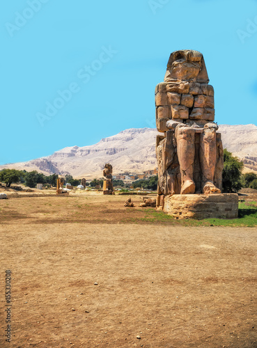 Photo Stands Egypt Egypt. Luxor. The Colossi of Memnon - two massive stone statues of Pharaoh Amenhotep III