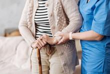 Gentle Trained Nurse Helping Mature Patient