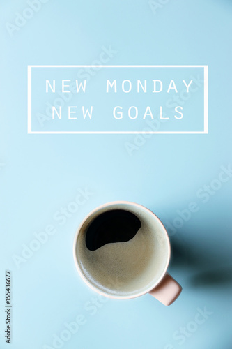 NEW MONDAY NEW GOALS Concept and Morning coffee on blue background