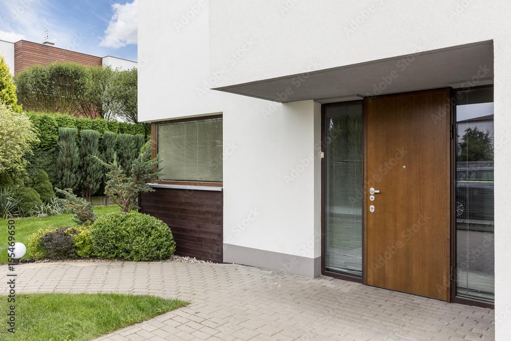 Fototapeta Wooden entrance door to modern house