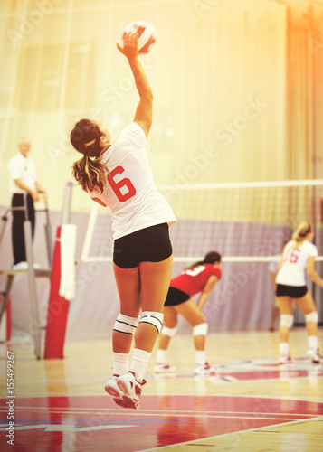 Anonymous woman playing volleyball