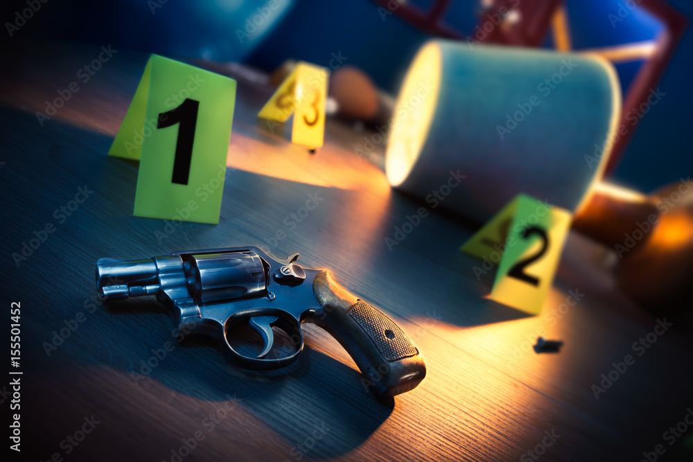 Fototapeta dramatic lit crime scene with gun and markers on the floor