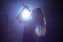 Cheerful Female Singer At Nightclub