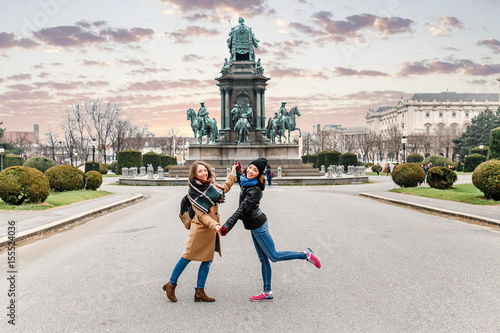 plakat Two happy woman friends meeting and hugging in Europe city, friendship and travel concept