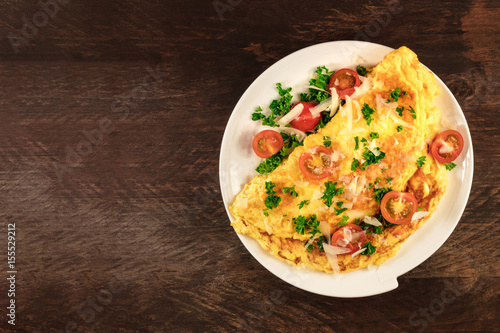 Omelette with parsley, cherry tomatoes, and copyspace