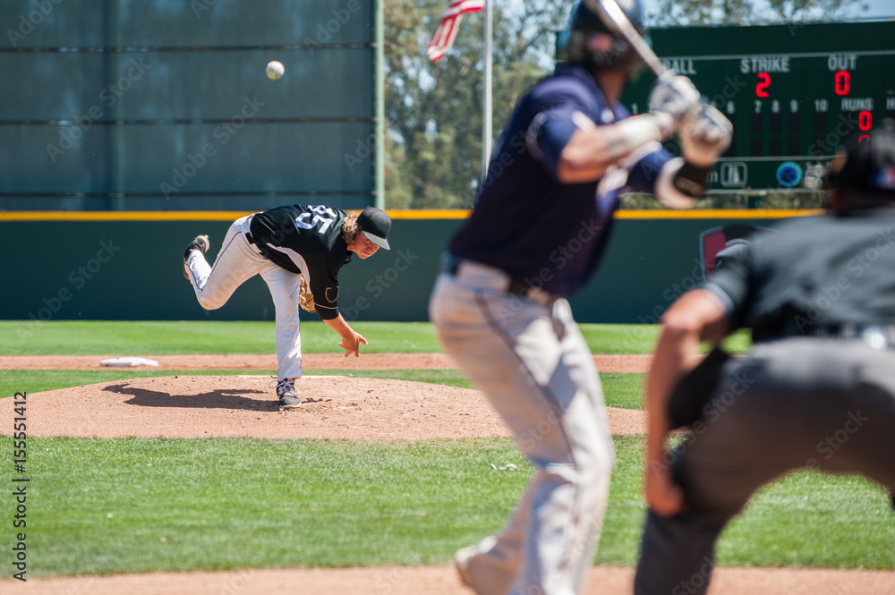 Fototapety, obrazy: Mens' baseball pitcher throwing the curveball to the batter.