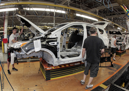 Louisville Assembly Plant employees work to assemble new 2013 Ford Escape on the production line at