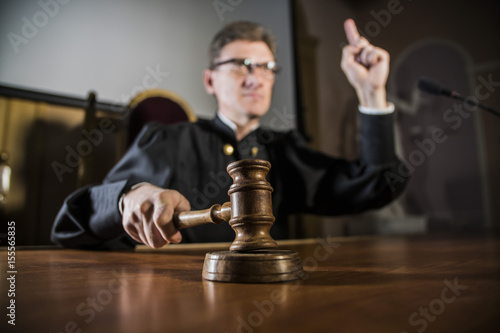 Fotografie, Obraz a judge with a hammer in his hand in the court room