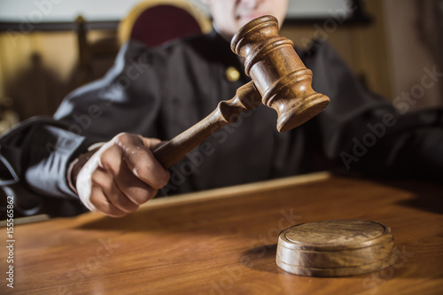 the hammer in the hand of the judge Canvas Print
