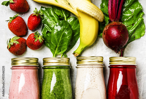 Multicolored smoothies and juices from vegetables, fruits and berries, food background, top view
