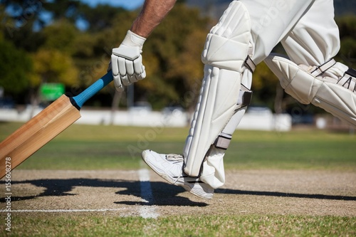 Cricket player scoring run on field