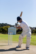 Determined Cricketer Playing O...