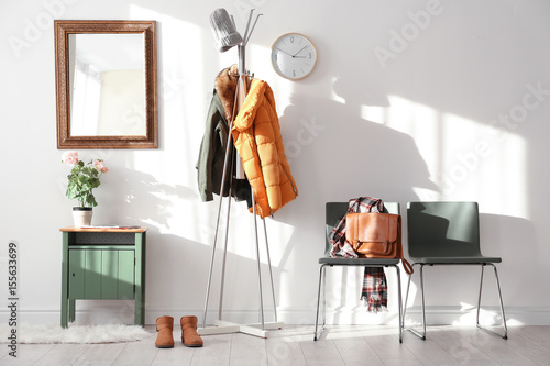 Fototapeta  Modern hall interior with hanging clothes