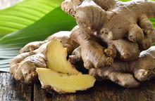 Fresh Ginger Root On Wooden Ba...