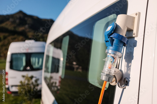 Photo  Campervan with 380v electricity plug in a camp