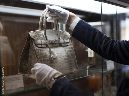 a6a5530753f5 An employee places an Hermes diamond and Himalayan Nilo Crocodile Birkin  handbag in a case at Heritage Auctions offices in Beverly Hills